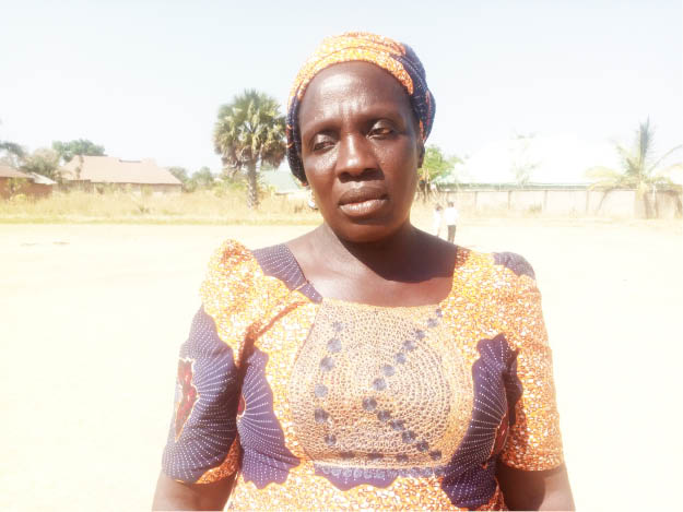 Alas Steven, mother of seven, whose house was burnt in Gora