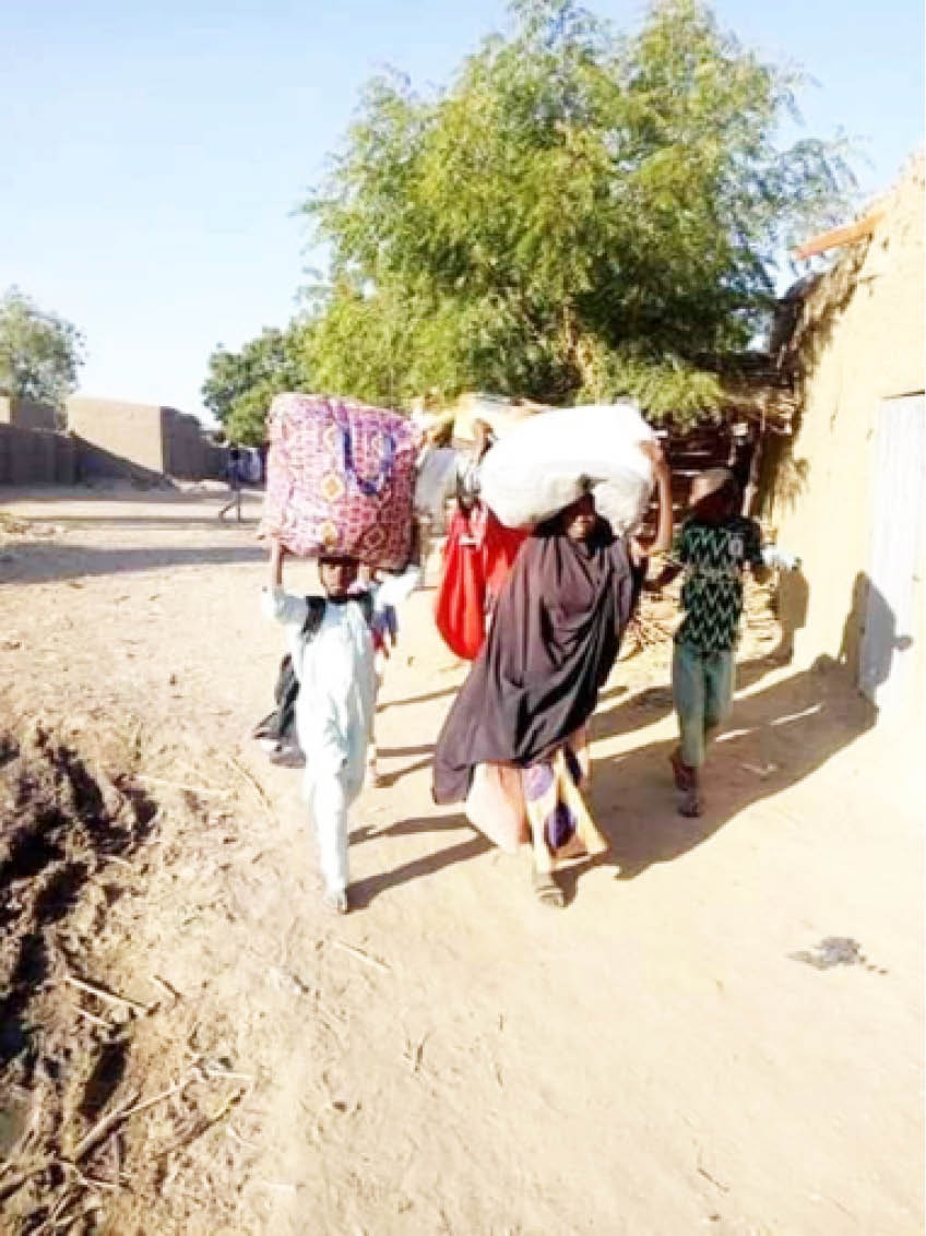 Villagers fleeing Garin Mallam after an attack by suspected herders