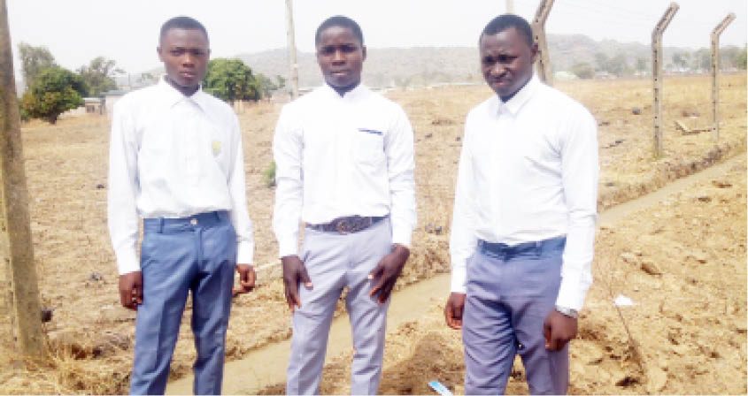 From right: Jethro Joshua, Andrew Mbai Velnoe and Favour Kim Peter who participated in the fence construction
