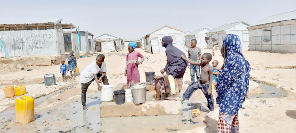 Children fetching water at the camp