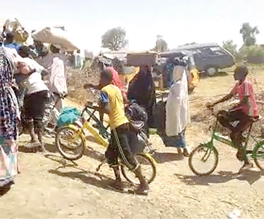 Displaced people from Damasak heading for Niger Republic yesterday. Photo: Captured from amateur video