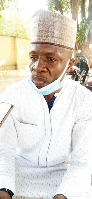 Traumatized, Dr Auwal has not been his usual self since the murder of his son a year ago. Now he believes the suspects' father is threatening him
