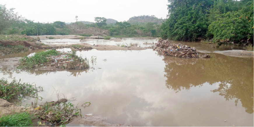 Debris in Mpape River, the main source of the six water channels that feed Usuma dam